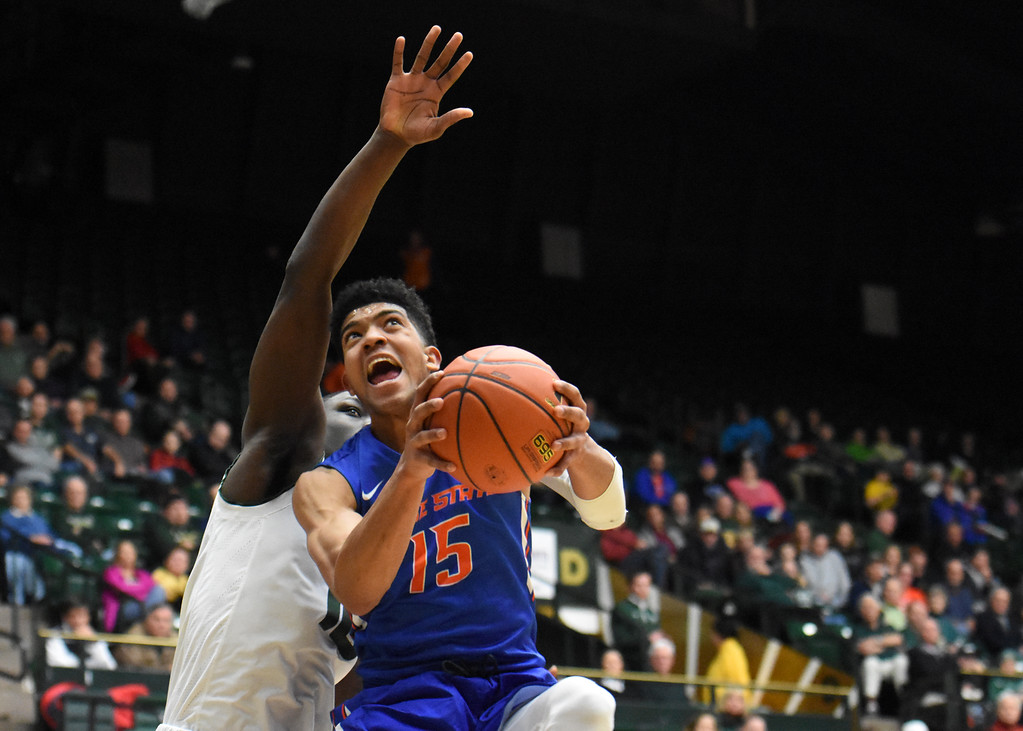 . Boise State\'s Chandler Hutchison (15) rises up to the basket against Colorado State defender Che Bob during their game February 22, 2018 at Moby Arena in Fort Collins. (Sean Star / Loveland Reporter-Herald)