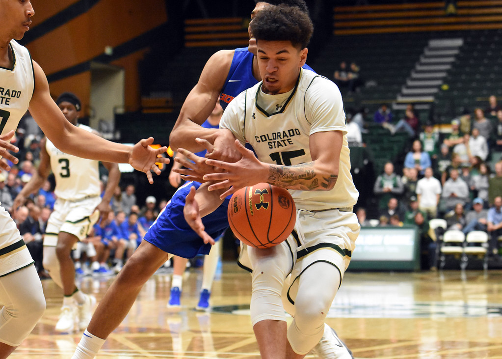 . Colorado State guard Anthony Bonner loses control of the ball as he\'s defended by Boise State\'s Chandler Hutchison during their game February 22, 2018 at Moby Arena in Fort Collins. (Sean Star / Loveland Reporter-Herald)