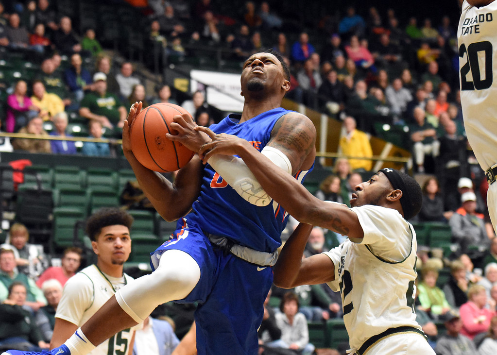. Boise State\'s Marcus Dickinson is defended by Colorado State\'s J.D. Paige during their game February 22, 2018 at Moby Arena in Fort Collins. (Sean Star / Loveland Reporter-Herald)