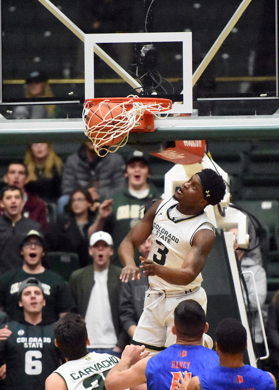 . Colorado State guard Raquan Mitchell watches his alley-oop attempt go in during a game against Boise State on Wednesday at Moby Arena. (Sean Star/Loveland Reporter-Herald)