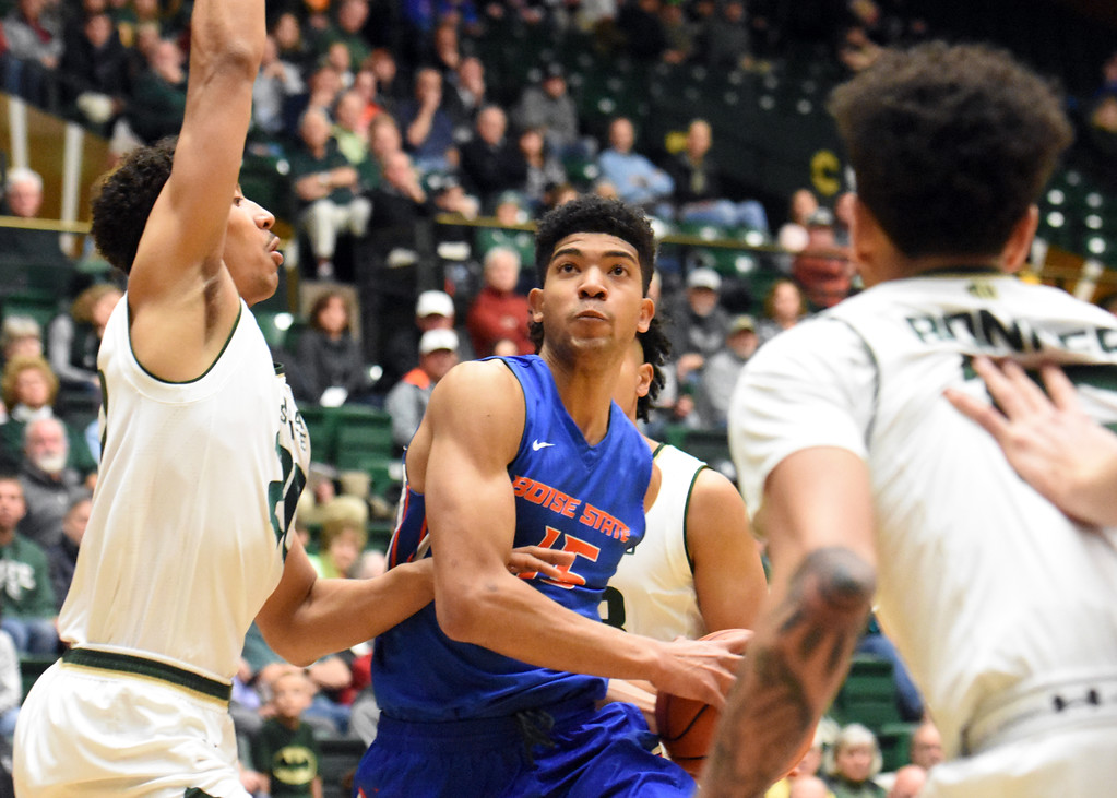 . Boise State\'s Chandler Hutchison drives to the basket against Colorado State defender Deion James, left, during their game February 22, 2018 at Moby Arena in Fort Collins. (Sean Star / Loveland Reporter-Herald)