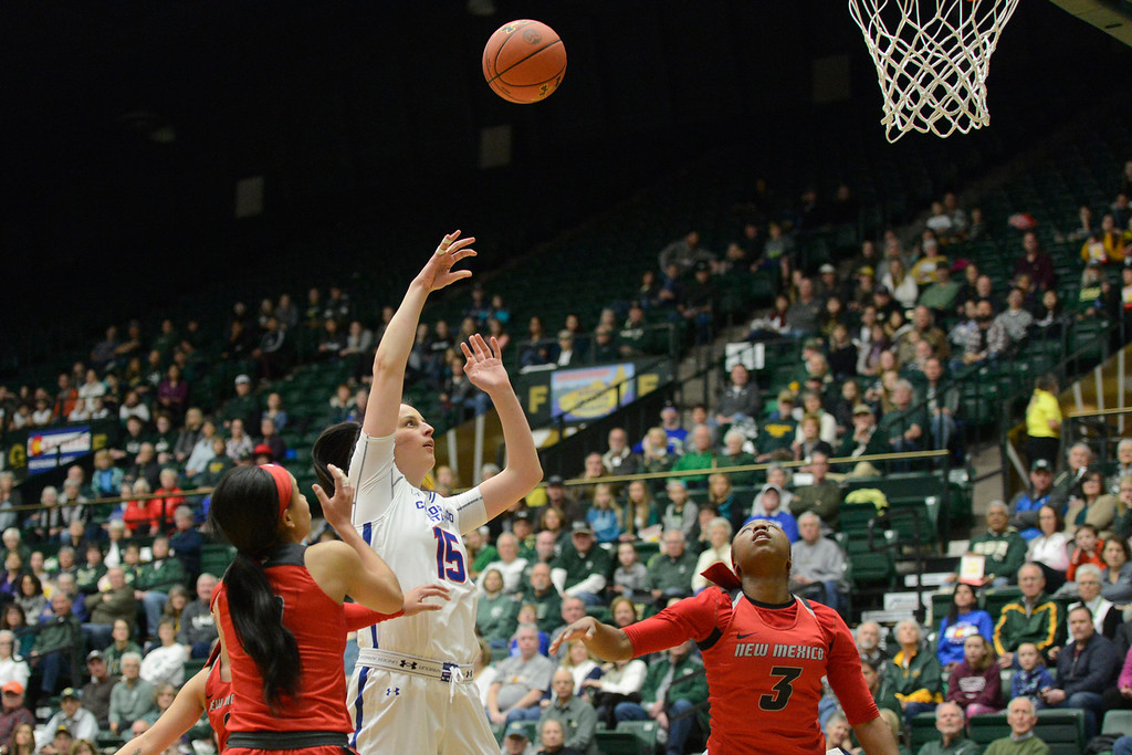 . Colorado State forward Veronika Mirkovic, middle, watches her shot next to a New Mexico defenders Cherise Beynon, left, and N\'Dea Flye on Saturday at Moby Arena. (Sean Star/Loveland Reporter-Herald)
