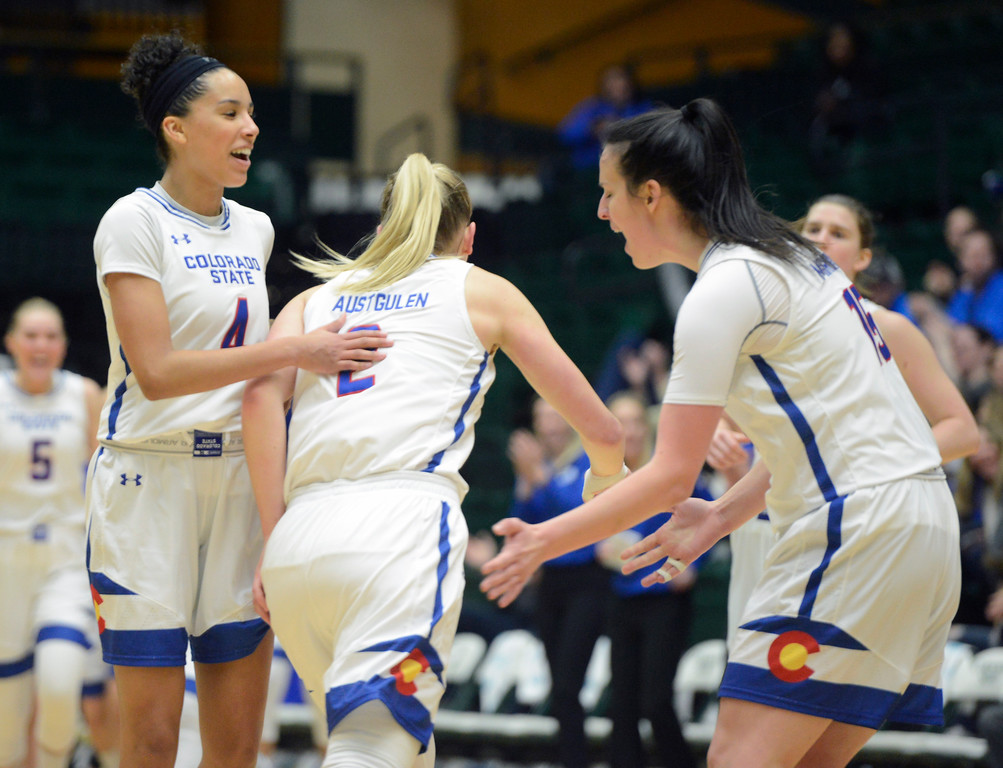 . Colorado State\'s Jordyn Edwards, left, congratulates Stine Austgulen, middle, along with Veronika Mirkovic during their game Saturday at Moby Arena. (Sean Star/Loveland Reporter-Herald)