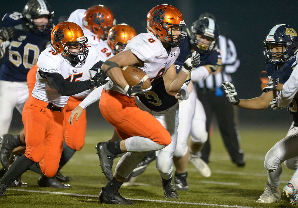 . Erie\'s Noah Roper carries the ball to score a 60 yard touchdown in the third quarter Friday night at Frederick High School. Erie won 40-24. To view more photos visit bocopreps.com. Lewis Geyer/Staff Photographer Nov. 03, 2017