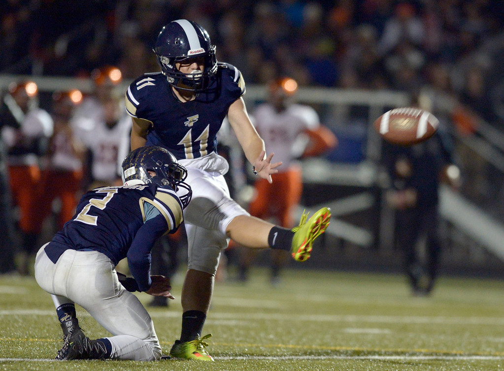 . With the help of Jake Green, Frederick\'s Luke Dunker kicks an extra point against Erie in the first quarter Friday night at Frederick High School. To view more photos visit bocopreps.com. Lewis Geyer/Staff Photographer Nov. 03, 2017