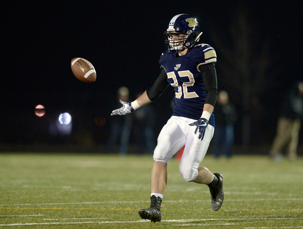 . Frederick\'s Jacob Cole tosses the ball on a reverse against Erie in the first quarter Friday night at Frederick High School. The play was called back due to a holding penalty. To view more photos visit bocopreps.com. Lewis Geyer/Staff Photographer Nov. 03, 2017