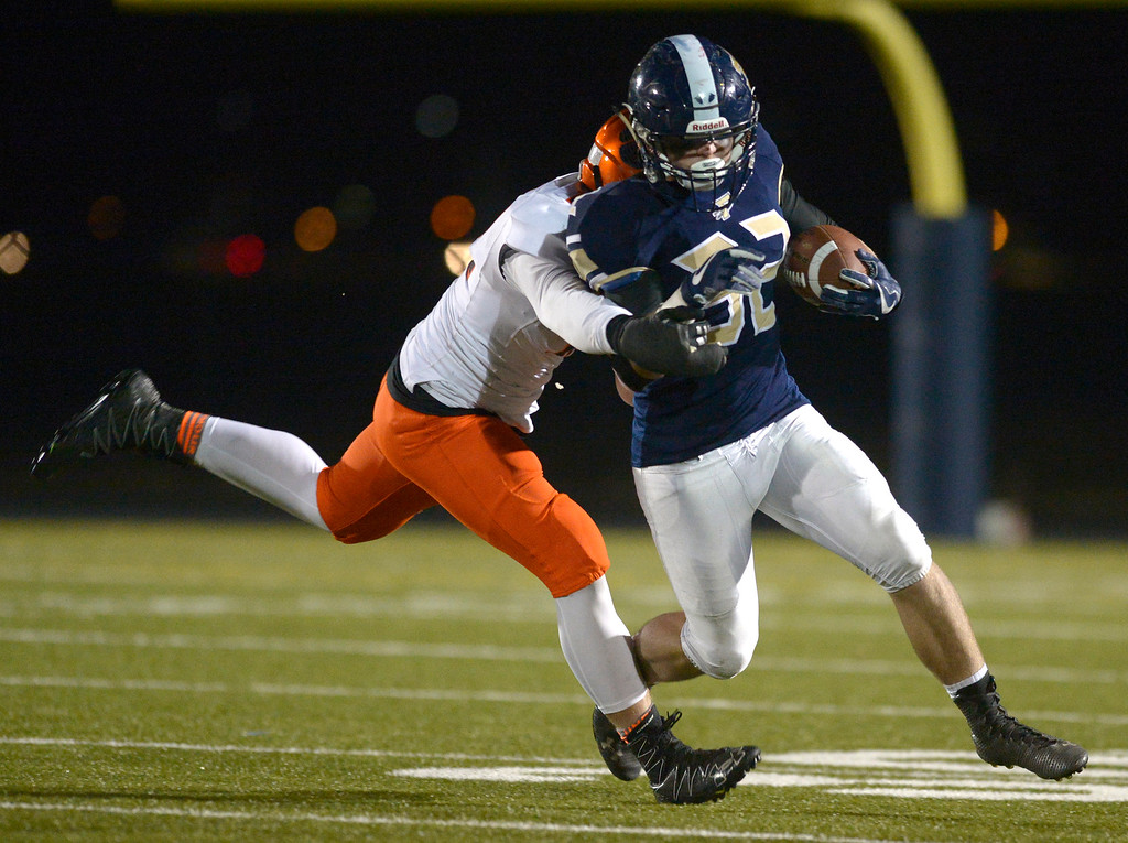 . Frederick\'s Jacob Cole is tackled by Erie\'s Josh Bradford in the third quarter Friday night at Frederick High School. Erie won 40-24. To view more photos visit bocopreps.com. Lewis Geyer/Staff Photographer Nov. 03, 2017