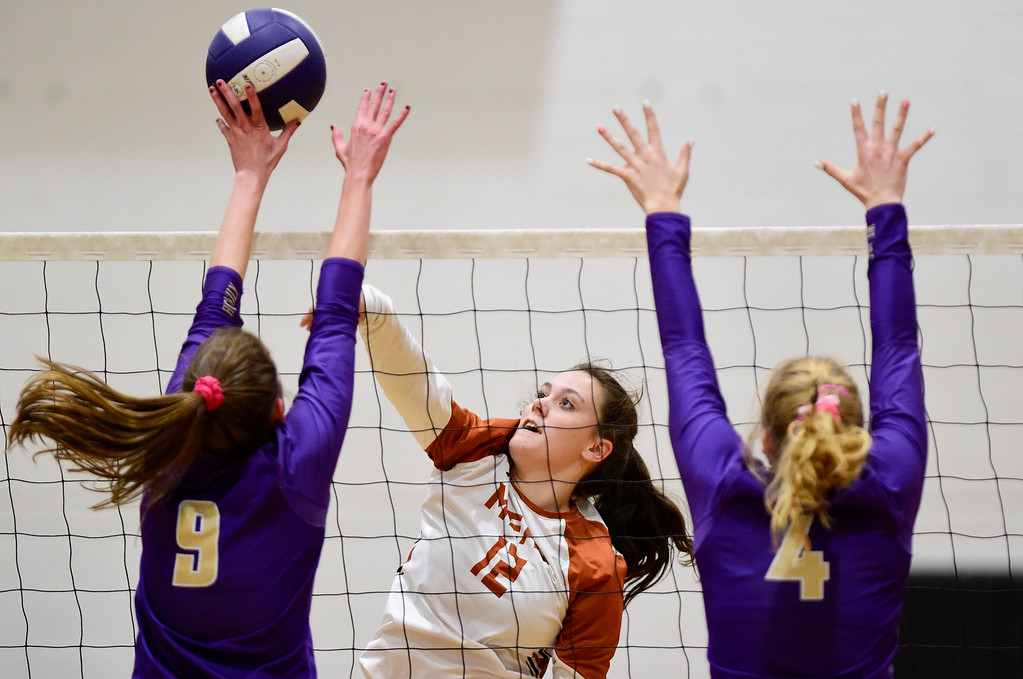 . BROOMFIELD, CO - OCTOBER 9:Holy Family High School\'s Abby Sawyer (No. 9) and Bianca Eldridge (No. 4) try to block a spike from Mead High School\'s Morgan Munro (No. 12) in Broomfield on Oct. 9, 2018. (Photo by Matthew Jonas/Staff Photographer)