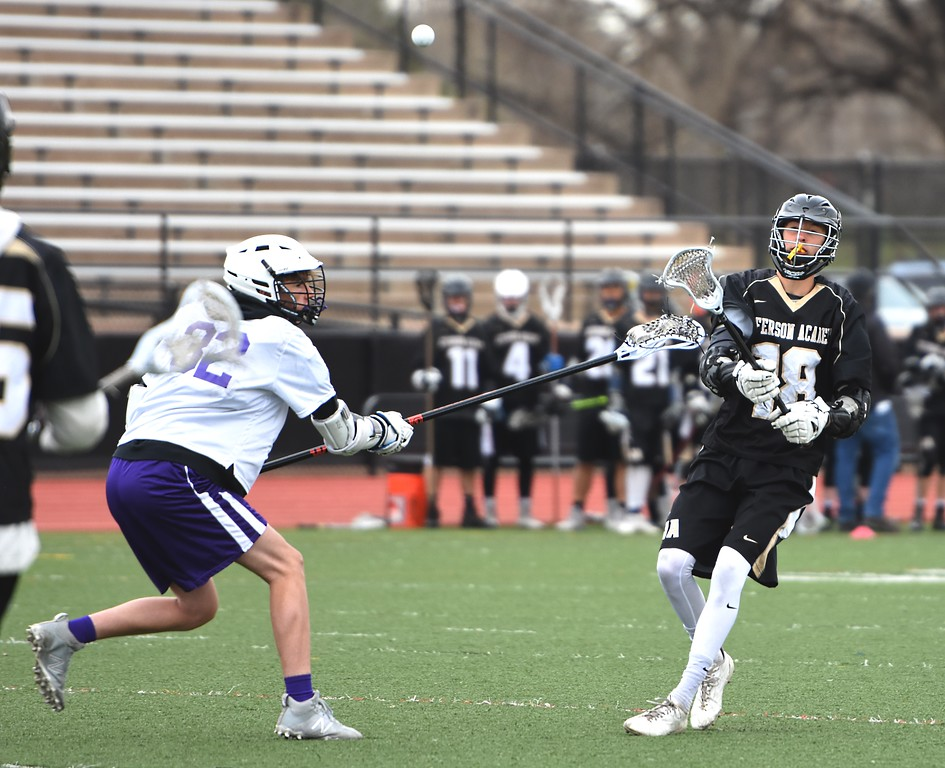 . Jefferson Academy\'s Riley Welsch passes to a teammate during the Jaguars\' game against Denver North on Friday, April 13, at All-City Stadium in Denver.