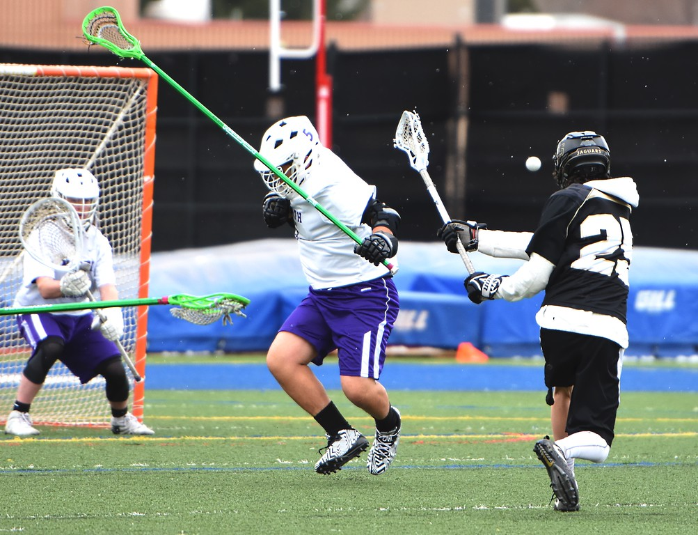 . Jefferson Academy\'s Isaac Mercurio shoots past a defender during the Jaguars\' game against Denver North on Friday, April 13, at All-City Stadium in Denver.