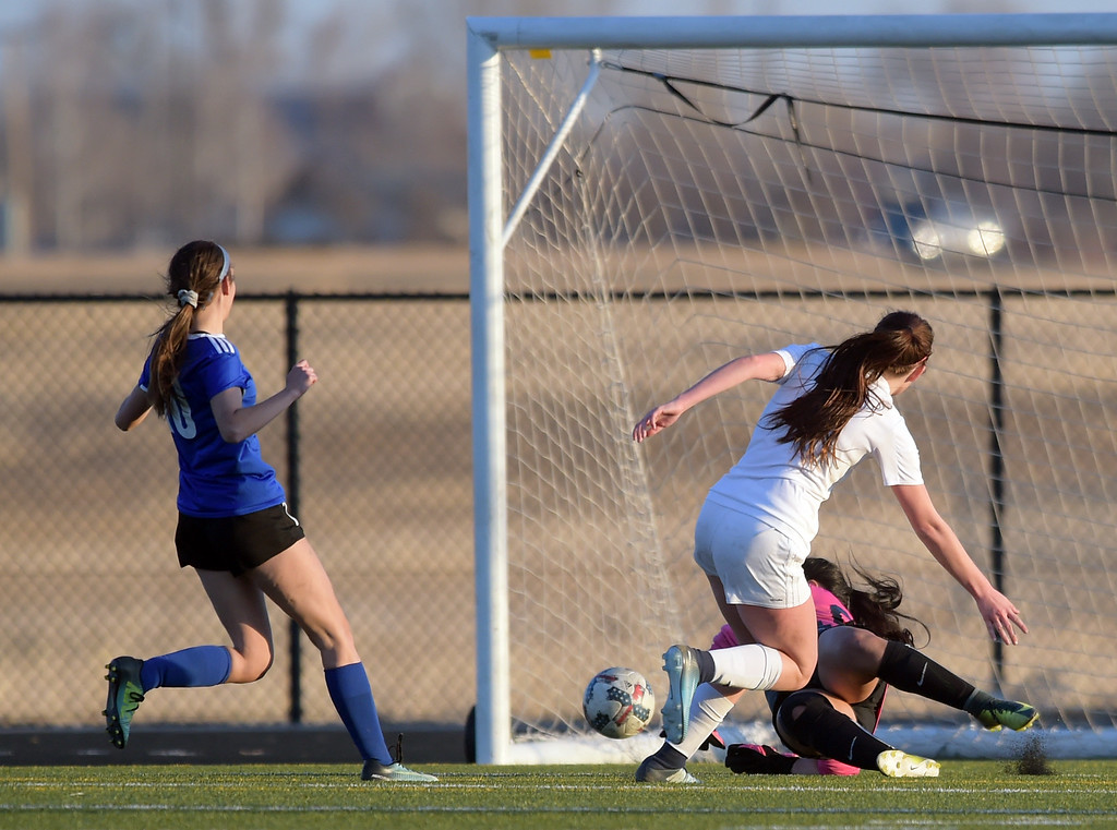 . Frederick\'s Makenzie te Velde slips the ball past Longmont goalie Franchesska Ramirez in the first half Tuesday night at Frederick High School. To view more photos visit bocopreps.com. Lewis Geyer/Staff Photographer March 13, 2018