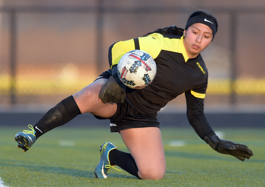 . Frederick goalie Jackie Castillo stops another Longmont kick in the first half Tuesday night at Frederick High School. To view more photos visit bocopreps.com. Lewis Geyer/Staff Photographer March 13, 2018
