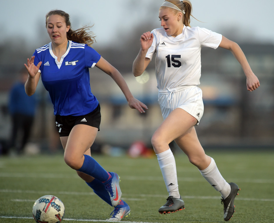 . Longmont\'s Mikaela Del Grosso and Frederick\'s Madeleine Chambers go after the ball in the second half Tuesday night at Frederick High School. To view more photos visit bocopreps.com. Lewis Geyer/Staff Photographer March 13, 2018