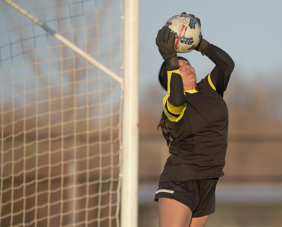 . Frederick goalie Jackie Castillo makes a save against Longmont in the first half Tuesday night at Frederick High School. To view more photos visit bocopreps.com. Lewis Geyer/Staff Photographer March 13, 2018