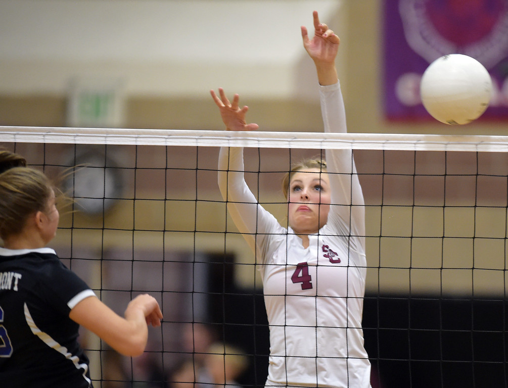 . Silver Creek\'s Emi Workman tries to block in the second game against Longmont at Silver Creek High School Thursday night. To view more photos visit bocopreps.com. Lewis Geyer/Staff Photographer Oct. 19, 62017