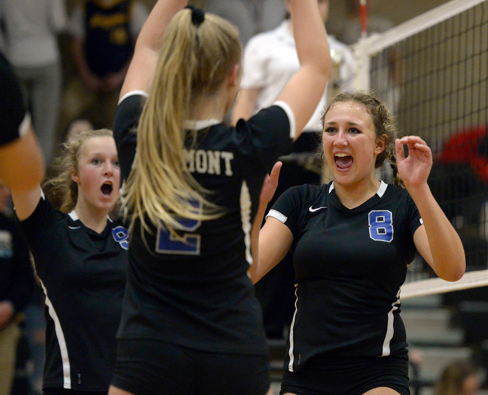 . Longmont\'s Kaitlyn Bridge, right, celebrates with Autumn Drees and Annika Wetterstrom after scoring a point against Silver Creek during the second game at Silver Creek High School Thursday night. To view more photos visit bocopreps.com. Lewis Geyer/Staff Photographer Oct. 19, 62017