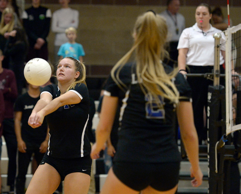 . Longmont\'s Jenna Johnson bumps the ball in the second game against Silver Creek at Silver Creek High School Thursday night. To view more photos visit bocopreps.com. Lewis Geyer/Staff Photographer Oct. 19, 62017