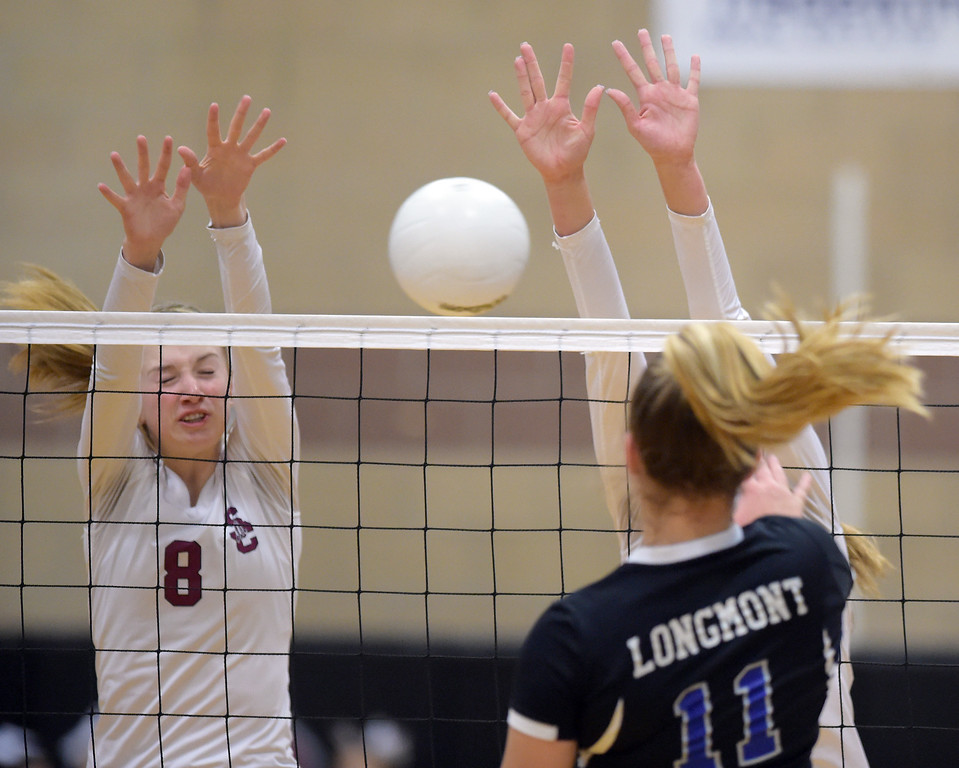 . Silver Creek\'s Katie James, left, and Caitlin Volkmann attempt to block a kill from Longmont\'s Rachel Kusbel at Silver Creek High School Thursday night. To view more photos visit bocopreps.com. Lewis Geyer/Staff Photographer Oct. 19, 62017
