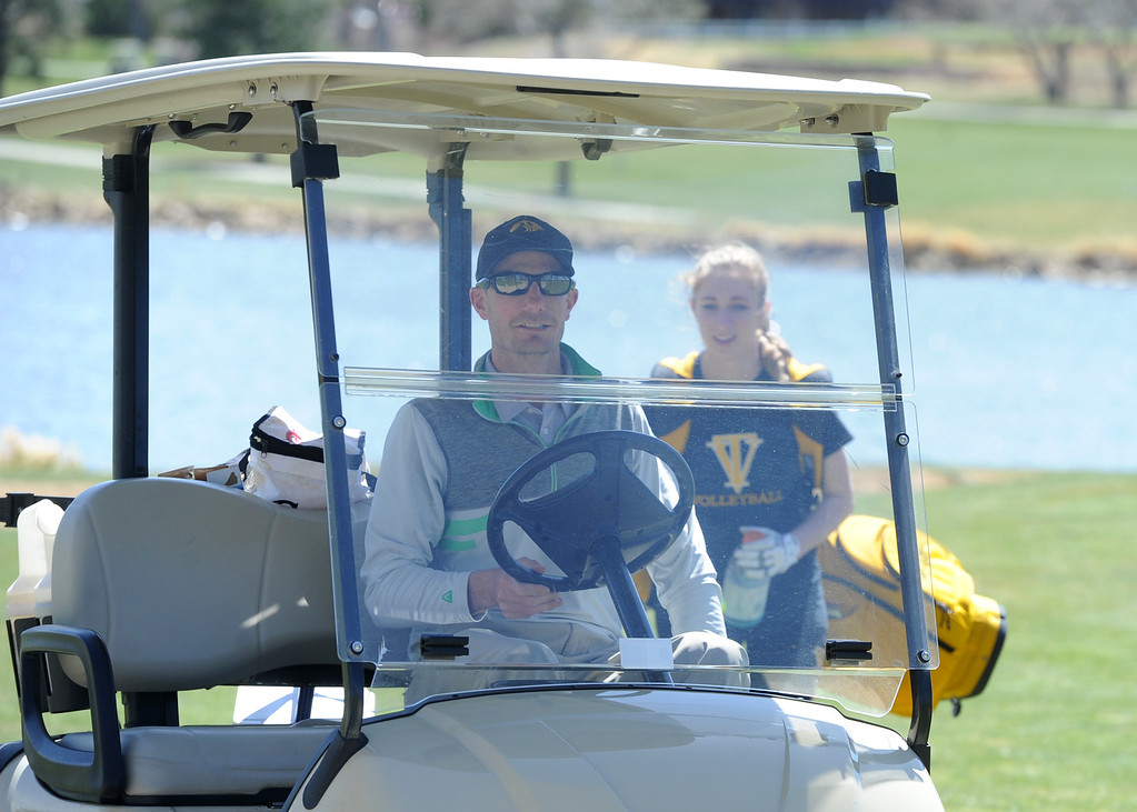 . Thompson Valley coach Derek Shagin drives to the ninth green during the Loveland Invitational on Wednesday, April 11, 2018 at the Olde Course at Loveland. (Sean Star/Loveland Reporter-Herald)