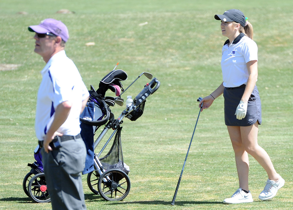 . Mountain View\'s Renee Demaree, right, and coach John Perry watch Demaree\'s approach shot on the 14th hole during the Loveland Invitational on Wednesday, April 11, 2018 at the Olde Course at Loveland. (Sean Star/Loveland Reporter-Herald)