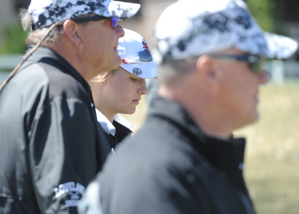 . Loveland\'s Lauren Lehigh, middle, waits for the fairway to clear alongside coaches Bill Stephens and Wayne McGinn during the Loveland Invitational at the Olde Course on Wednesday, April 11, 2018. (Sean Star/Loveland Reporter-Herald)