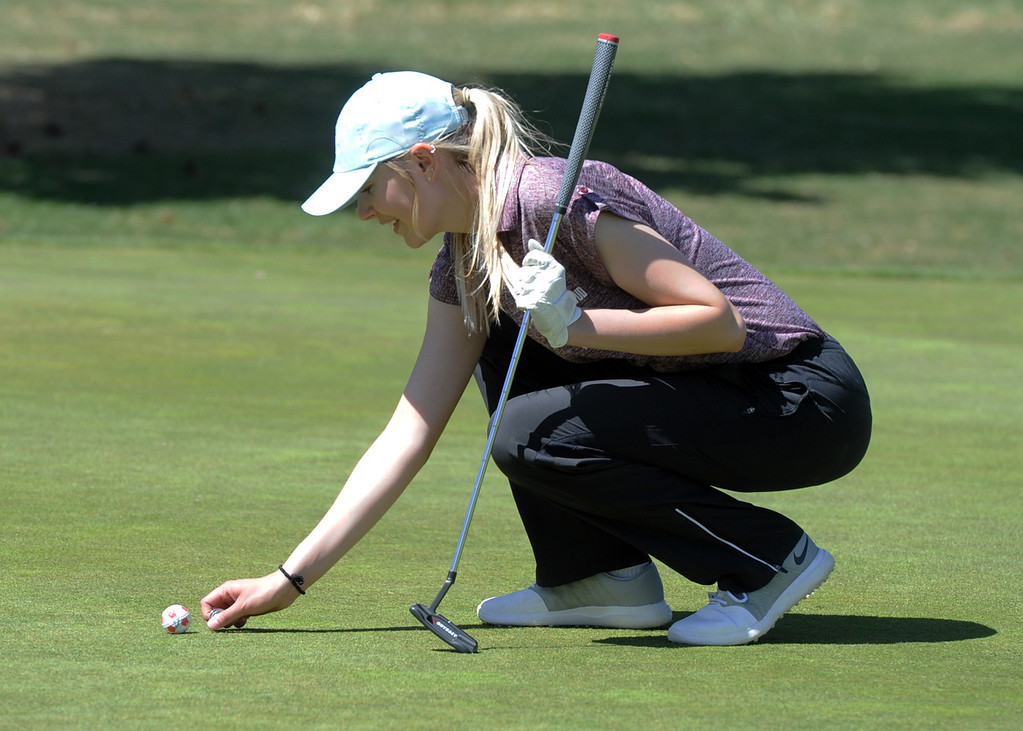 . Berthoud\'s Kyra McDonald marks a putt during the Loveland Invitational on Wednesday, April 11, 2018 at the Olde Course at Loveland. (Sean Star/Loveland Reporter-Herald)