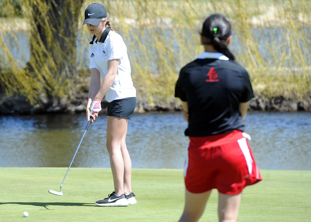 . Mountain View\'s Isabella Romero watches a putt during the Loveland Invitational on Wednesday, April 11, 2018 at the Olde Course at Loveland. (Sean Star/Loveland Reporter-Herald)