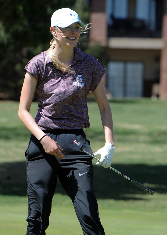 . Berthoud\'s Kyra McDonald walks off the 12th green during the Loveland Invitational on Wednesday, April 11, 2018 at the Olde Course at Loveland. (Sean Star/Loveland Reporter-Herald)