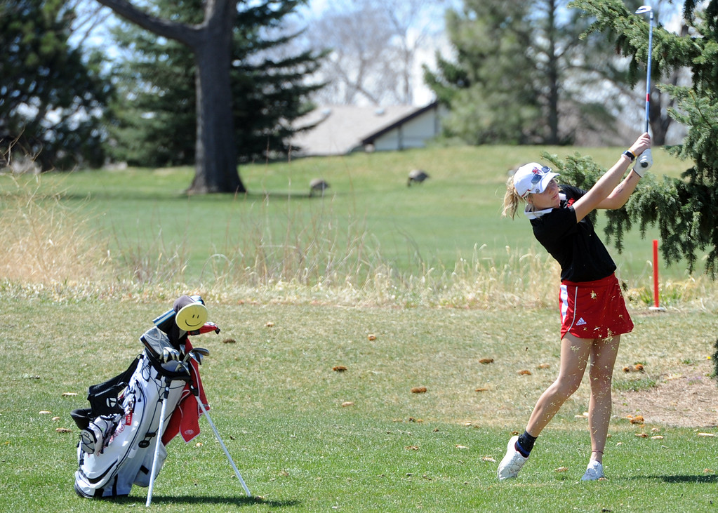 . Loveland\'s Lauren Lehigh swings from the left rough during the Loveland Invitational at the Olde Course on Wednesday, April 11, 2018. (Sean Star/Loveland Reporter-Herald)
