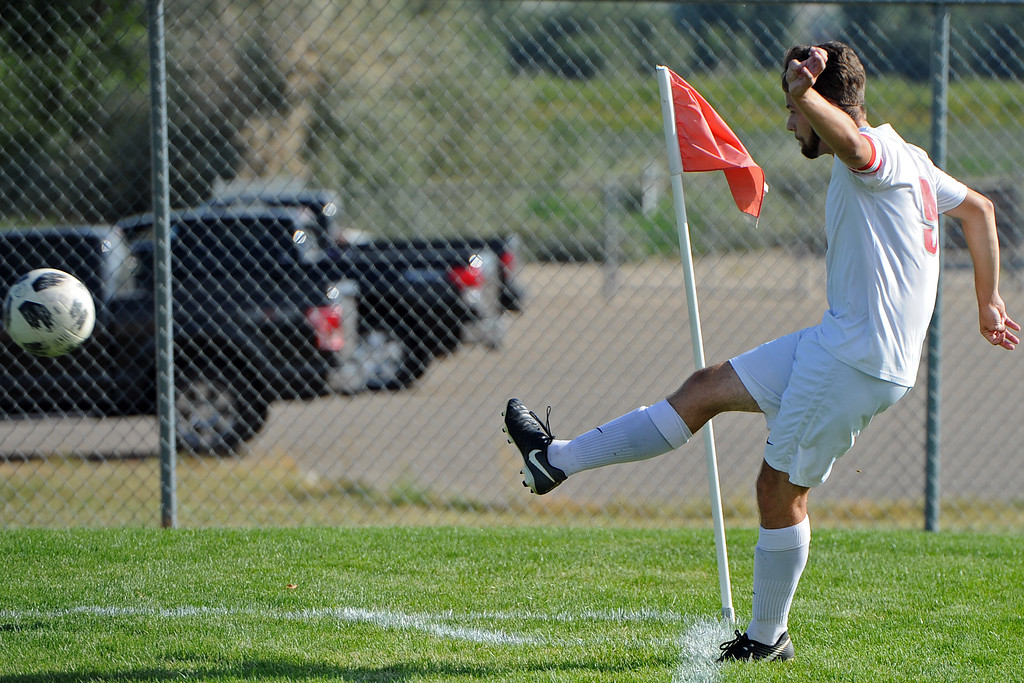 . Loveland\'s Connor Bergstrom takes a corner kick during a game Tuesday, Sept. 4, 2018 at Mountain View High School in Loveland. (Sean Star/Loveland Reporter-Herald)