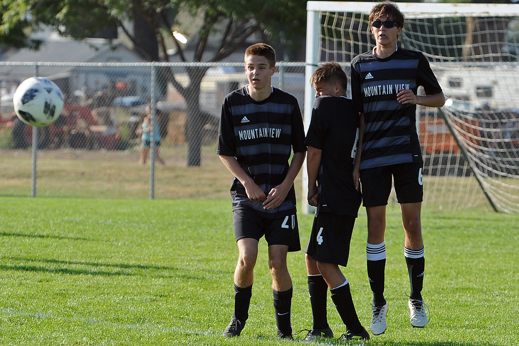 . Mountain View\'s (from left) Brevan Branscum, Tyler Martinez and Brendan Clark line up to block a free kick during a game Tuesday, Sept. 4, 2018 at Mountain View High School in Loveland. (Sean Star/Loveland Reporter-Herald)