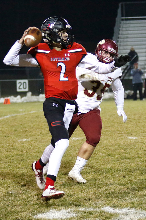 . Loveland�s Riley Kinney (2) reaches back to pass the ball before Ponderosa�s Ethan Waite (35) can sack him  on Friday, Nov. 10, 2017, at Patterson Stadium in Loveland. (Photo by Lauren Cordova/Loveland Reporter-Herald)