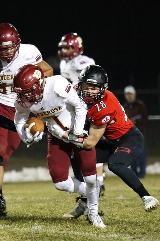 . Loveland�s Cody Donovan (28) tackles Ponderosa�s Chris Shaw (7) on Friday, Nov. 10, 2017, at Patterson Stadium in Loveland. (Photo by Lauren Cordova/Loveland Reporter-Herald)