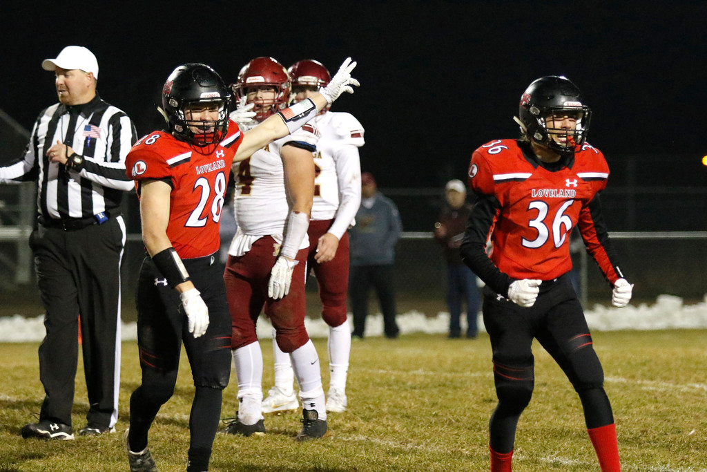 . Loveland�s Cody Donovan (28) and Karl Dunlap (36) celebrate after taking the ball back from Pondersoa  on Friday, Nov. 10, 2017, at Patterson Stadium in Loveland. (Photo by Lauren Cordova/Loveland Reporter-Herald)