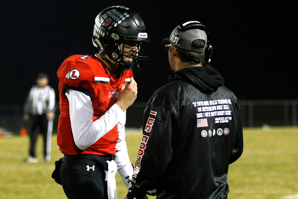 . Loveland�s Riley Kinney (2) talks to Jeff Mauck, offensive coordinator, before a play on Friday, Nov. 10, 2017, at Patterson Stadium in Loveland. (Photo by Lauren Cordova/Loveland Reporter-Herald)