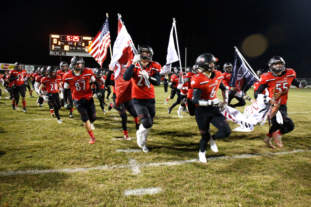 . The Loveland Indians� varisty team rushes the field for a playoff game against the Ponderosa Mustangs on Friday, Nov. 10, 2017, at Patterson Stadium in Loveland. (Photo by Lauren Cordova/Loveland Reporter-Herald)