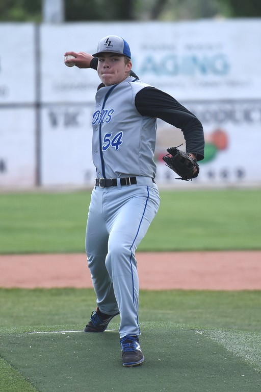 . Lyons starting pitcher Austen Clark delivers a pitch during the Lions\' Class 2A state semifinal game against Rocky Ford on Saturday at Runyon Field Sports Complex in Pueblo.