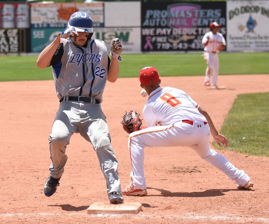 . Lions third baseman Keegan Bean beats the throw and is safe after going from first to third on a single to right field during the Lions\' Class 2A state semifinal game against Rocky Ford on Saturday at Runyon Field Sports Complex in Pueblo.