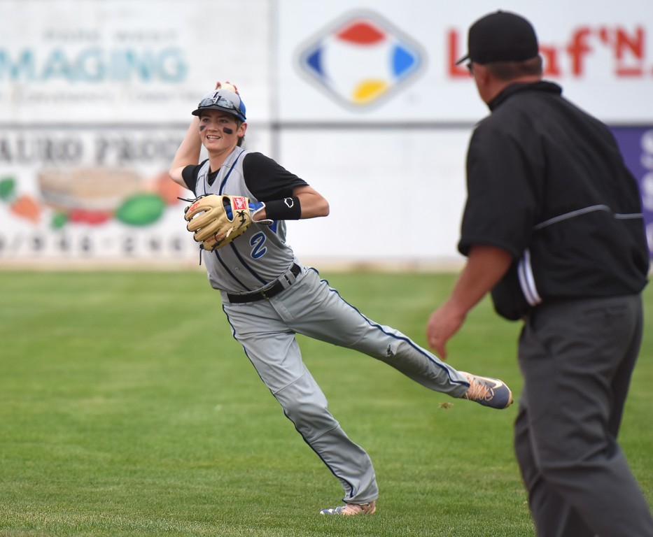 . Lyons second baseman Joe McCain makes an off-balance throw from deep in the hole while trying to make an out at first base during the Lions\' Class 2A state semifinal game against Rocky Ford on Saturday at Runyon Field Sports Complex in Pueblo.