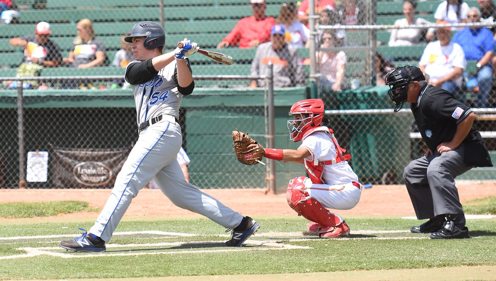 . Lyons\' Austen Clark drives the baseball to right-center field during the Lions\' Class 2A state semifinal game against Rocky Ford on Saturday at Runyon Field Sports Complex in Pueblo.