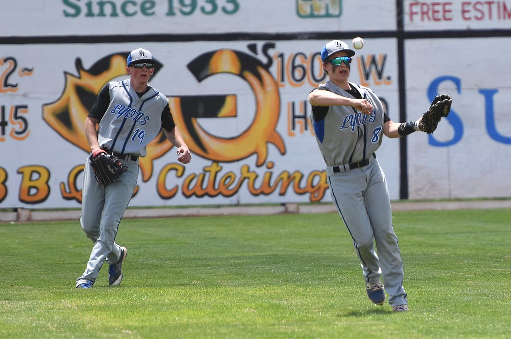 . Lyons freshman center fielder Jake Owens throws to the cut-off man during the Lions\' Class 2A state semifinal game against Rocky Ford on Saturday at Runyon Field Sports Complex in Pueblo.