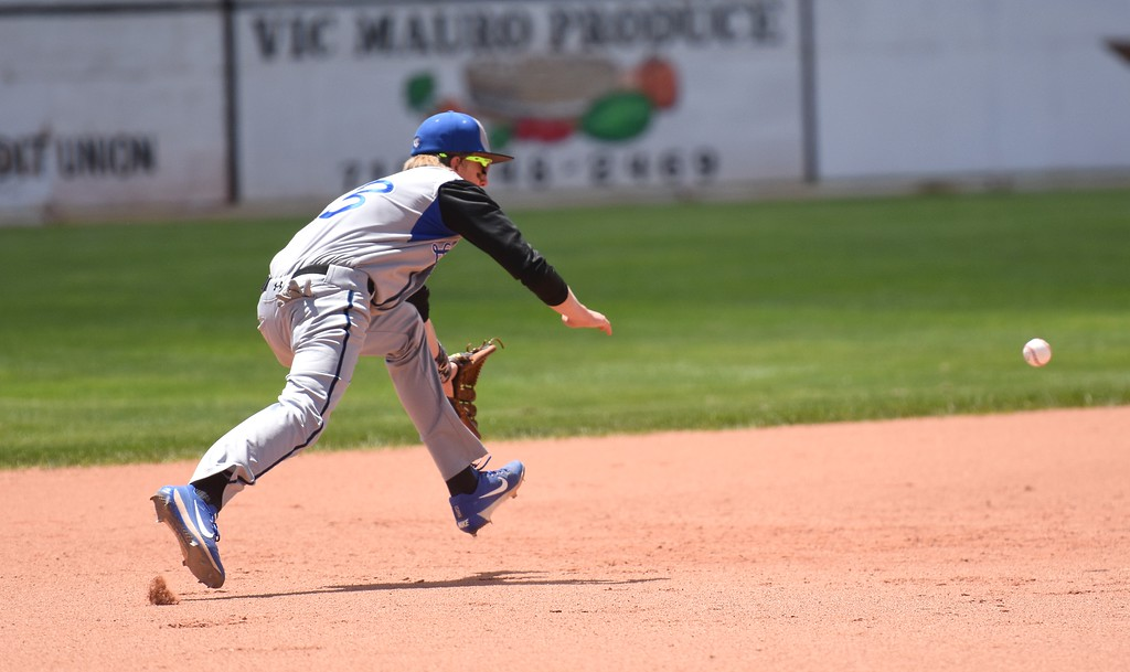 . Lyons shortstop Dawson Kelly dives for a ground ball up the middle during the Lions\' Class 2A state semifinal game against Rocky Ford on Saturday at Runyon Field Sports Complex in Pueblo.