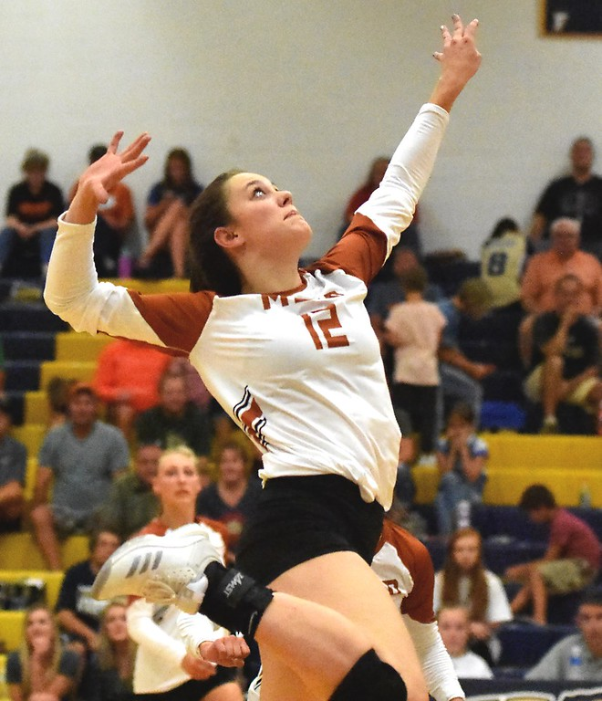 . Mead\'s Morgan Munro goes up for a kill against Frederick during the teams\' match on Tuesday, Sept. 11, at Frederick High School.