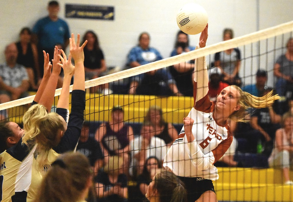 . Mead\'s Abbey Glynn hits against Frederick during the teams\' match on Tuesday, Sept. 11, at Frederick High School.