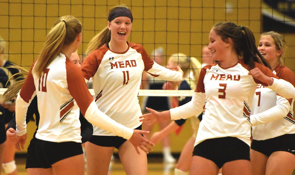 . The Mead volleyball team celebrates a kill during the teams\' match on Tuesday, Sept. 11, at Frederick High School.