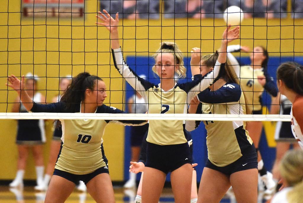 . The Frederick Warriors ready for a serve against Mead during the teams\' match on Tuesday, Sept. 11, at Frederick High School.