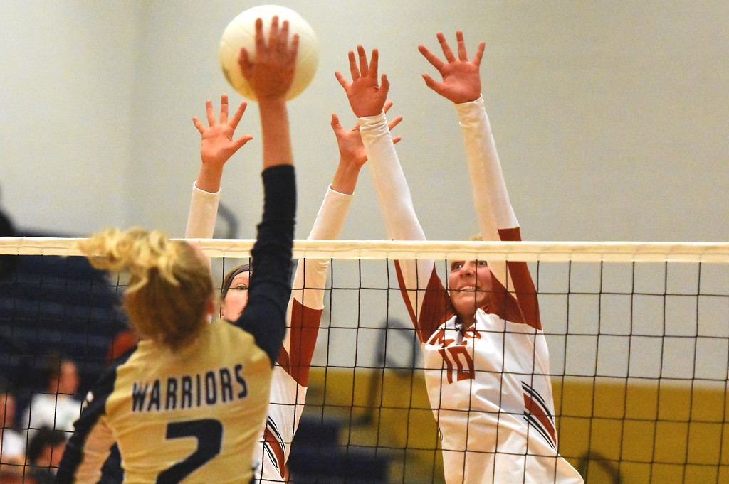 . The Mead front line goes up to block against Frederick during the teams\' match on Tuesday, Sept. 11, at Frederick High School.