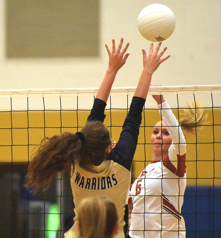 . Mead\'s Abbey Glynn pops the ball over the Frederick block during the teams\' match on Tuesday, Sept. 11, at Frederick High School.