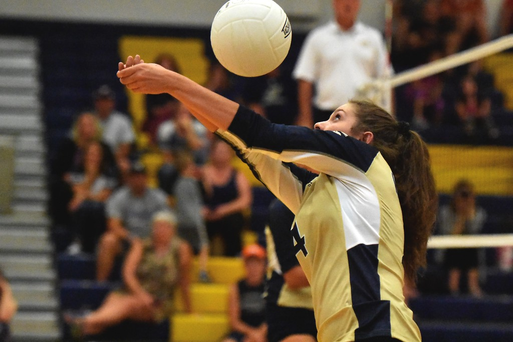 . Frederick\'s Josi Revielle plays the ball over the net against Mead during the teams\' match on Tuesday, Sept. 11, at Frederick High School.