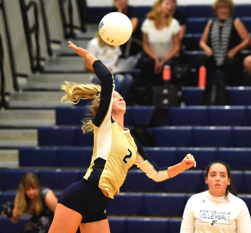 . Frederick\'s Bailey Baumgardner hits against Mead during the teams\' match on Tuesday, Sept. 11, at Frederick High School.